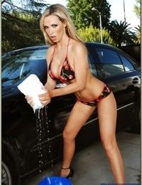Luxurious babe Nikki Benz strips from bikini and washing a car outdoor