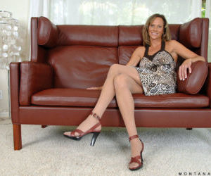 Older blonde woman Montana Skye removes her dress before fingering her pussy