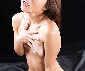 Naked Japanese female Aoi Shino gets a cum facial after sucking cock
