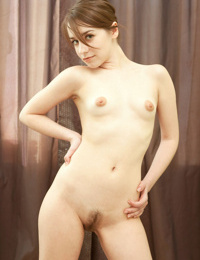 Young amateur girl Yulia showcases her hairy European pussy in the nude
