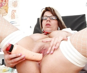 Juggy mature nurse stuffing her cunt with vibrator and gyno tool
