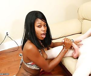 Delicious ebony babe kneels down and takes care of a white cock