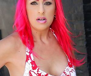Pink-haired MILF Raven Black gets a big black cock inside of her pussy