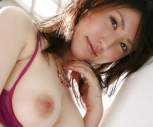 Sexy asian babe in lingerie Takako Kitahara uncovering her petite jugs