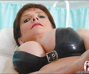 Juggy mature fetish minx in BDSM outfit has no panties under her pantyhose
