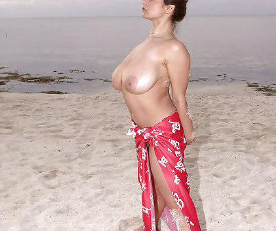 Buxom French MILF Chloe Vevrier spreading hairy pussy outdoors on beach