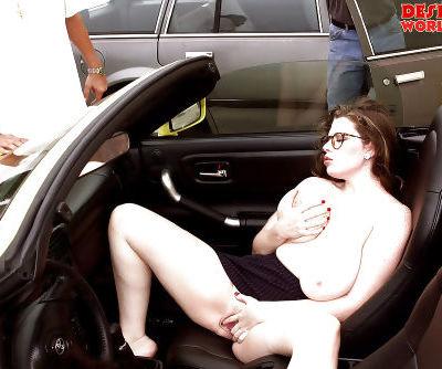 Glasses adorned solo girl unleashing massive pornstar juggs outdoors
