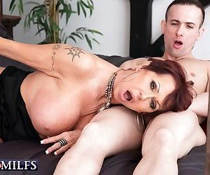 Mature lady Gina Milano opens her mouth wide for a cumshot after fucking