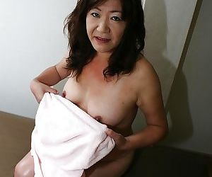 Saucy asian granny Michiko Okawa toying her hairy twat after shower