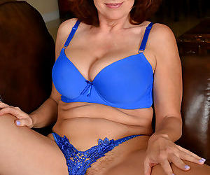 Mature wife Andi James strips blue lace panties to spread for pussy closeup