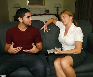 Busty female Amber Lynn Bach undresses before jerking off her stepson