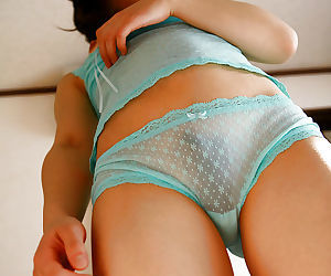 Petite asian babe with hairy pussy Momo Yoshizawa posing in lingerie