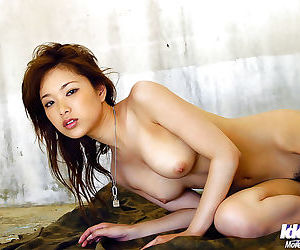 Asian cutie Yua Aida getting her clothes wet and uncovering her graceful body