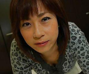 Asian MILF Mari Teramura getting naked and exposing her juicy slit