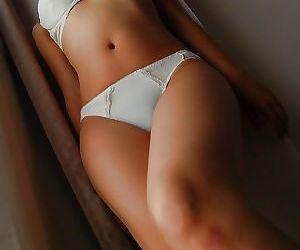 Asian MILF Ryoko Morikawa undressing and exposing her hairy gash in close up