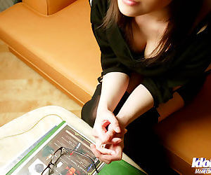 Alluring asian babe in glasses lets a guy to play with her hairy pussy
