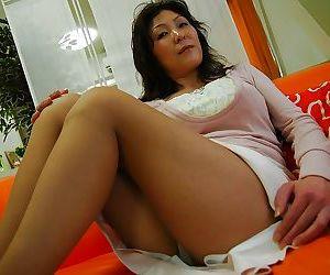 Busty asian MILF Masako Suzuki getting naked and spreading her lower lips