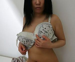 Sassy asian MILF undressing and spreading her hairy pussy in close up