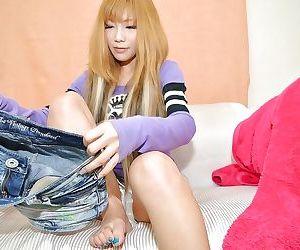 Asian teenage cutie Saki Oshiro gets bottomless and vibes her clit