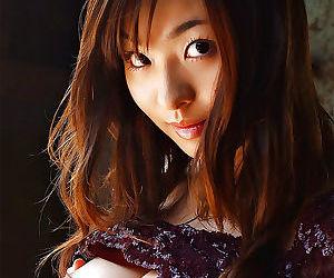 Sweet asian teen Hikaru Koto revealing her petite tits and hairy pussy