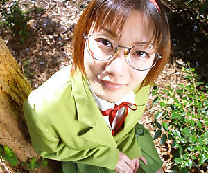 Naughty asian babe in glasses and school uniform revealing her titties
