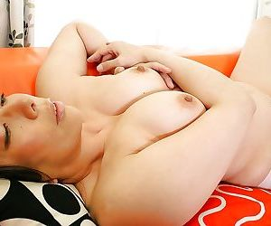 Chubby asian MILF Kimiko Yasue getting naked and playing with her sex toys