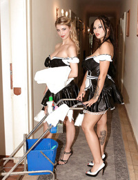 Two busty lesbian maids in uniform play with their big jugs