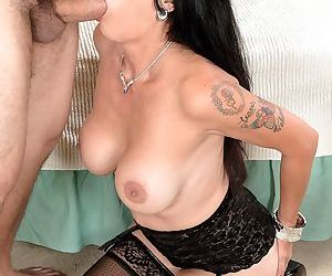 Mature woman in black lingerie Moreen Helm has anal fun with a young man