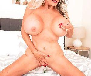 Petite granny Sally DAngelo enjoys showing off her big fake tits