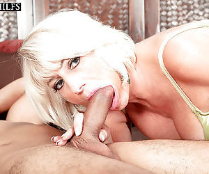 Mature lady Desire Collins seducing younger Latino male for sex