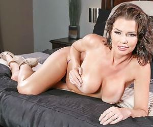 MILF Veronica Avluv loves to strip of her clothes in her bedroom