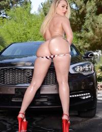 Outdoor posing scene featuring an oiled AJ Applegate in a sexy bikini