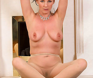 Hot mature Marlyn spreads in sheer pantyhose & stretches naked pussy lips wide