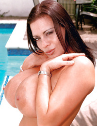 Blistering MILF Linsey Dawn McKenzie showing huge tits in the pool