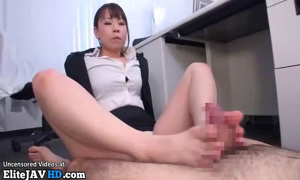 Japanese office lady gives a hot footjob