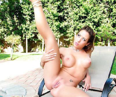 Slutty doll slams her juicy twat in a sexy outdoor pool masturbation