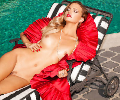 Redhead beauty Amanda Booth likes to play naughty and sensual in sexy outdoor solo