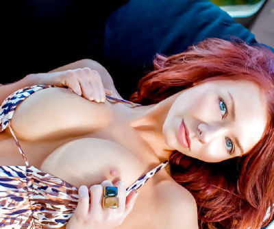 Hot redhead chick Alyssa Michelle demonstrates her huge bouncing knockers and its her main quality