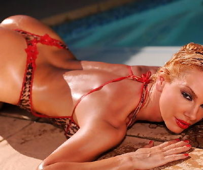 Tight ass chick slips into the cool pool water and keeps her red lipstick on