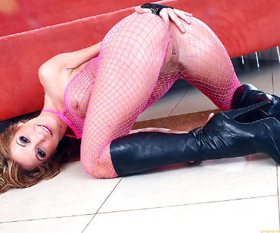 Curly haired princess in black boots is demonstrating her appetizing ass on the sofa