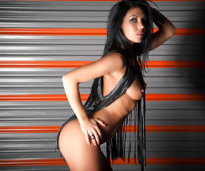 Amazing and pretty lady with dark hair is showing her appetizing backdoor in the room