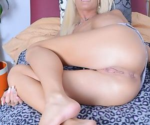 Blonde chick Olivia Blu parts her meaty labia lips with her fingers