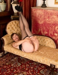 Mature Kitty Creamer loves to wear stockings while shes showing off her pussy