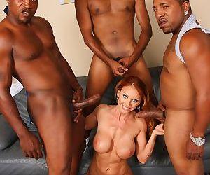 Older redhead Janet Mason fucks 3 black studs while her son watches hr