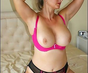 Plump mature lady with huge boobs fucking her shaved pussy with a thick dildo