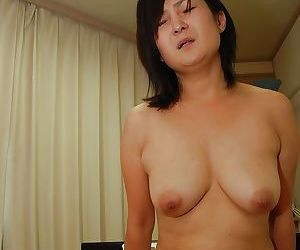 Naughty japanese MILF gives a titjob and gets her hairy pussy boned-up