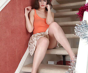Busty housewife Katie flashes panties under skirt on stairs