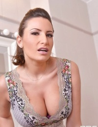European solo girl Sensual Jane unveiling large MILF boobs in high heels