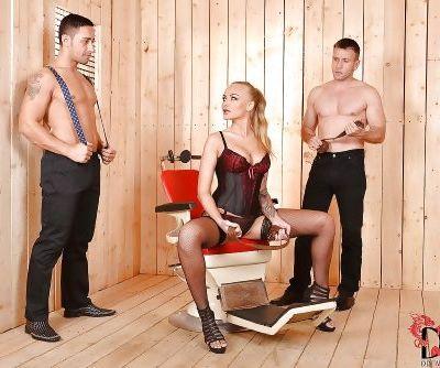 Ravishing BDSM vixen in nylons and girdle has some DP fun with hung guys