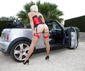 Hot Euro lady Jan Burton flashing stocking tops and garters outdoors - part 2